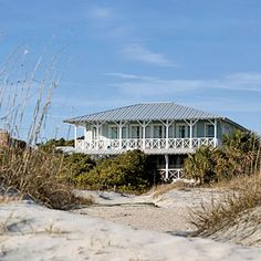 """Stella and Dave Peterson's coastal Georgia vacation home has all the classic details—broad porches, exposed rafter tails—of a century-old house. But it was only built to look that way. """"I'm an old-house person, but I've realized you can build character into new construction and create your own history,"""" Stella says."""