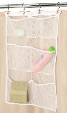 DIY Tips for an Organized Bathroom - Shower Hack - Use a Mesh Bath and Shower Organizer that hangs from the curtain rod rings to hold your shampoos etc