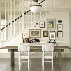 Classic cottage.  Gallery wall + paneling