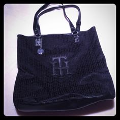 "Large black Tommy Hilfiger purse Large black purse. Can hold a 17"" laptop. Great quality bag. Tommy Hilfiger Bags"