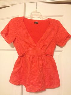 J.Crew size 2 orange and white polka dot short sleeve tie back top. Super cute! Fits up to at least a 4 because of the tie. Probably a 6. $20 shipped