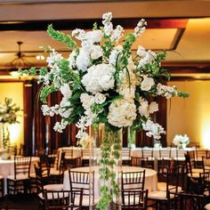 Stunning centerpiece of roses, hydrangeas, tulips, orchids, larkspur, bells of Ireland and greenery | Heather Ann Design & Photography | College Flowers