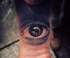 Eye on the prize: A blinking grey eye looks up from the forearm of one of Moreno's clients