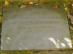 Alice (1852-1934) was born Alice Pleasance Liddell, but the epitaph for her ashes in the graveyard of the church of St. Michael & All Angels, Lyndhurst, doesn't bear her name, per se, leaving her last mortal footprint as Mrs. Reginald Hargreaves