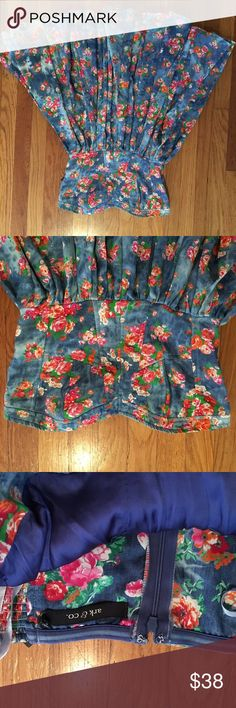Strapless floral cowgirl dress. Size 4 true to size strapless brand new floral dress. Very girlie and comfy. Blue with pink and orange vintage print flowers. Comes with optional straps. Back zipper and hook. Ark & Co Dresses Mini