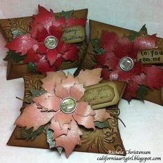 Design team member Richele Christensen created these gorgeous pillow box gift packages featuring the new @Tim Holtz Tattered Poinsettia die. Find her tutorial at http://sizzixblog.blogspot.com/2012/11/die-cutting-paper-holiday-gift-box.html.