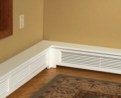 Baseboard Covers. Pardon me for liking this way to cover nasty baseboard heaters that stick out so oddly.