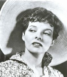 30s-era Katharine Hepburn rocking a pixie and a straw hat in wacky gender bender flick Sylvia Scarlett