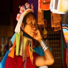 """Depart by local truck to Ban Nai Soi, a Karen Hilltribe village. There are approximately 300,000 Karens in Thailand, making them by far the most populous minority group in the country. The Karen tribe inhabits many areas of western and northern Thailand and can be divided into several sub-groups. The Padaung, the famous """"long-neck"""" people whose women traditionally wear many tight bronze rings around their necks, are another of the many sub-groups. The women of the Padaung stretch their necks…"""