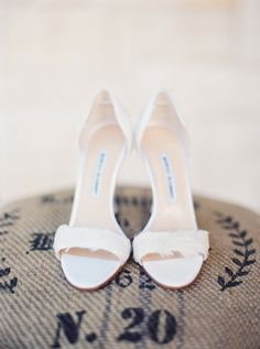 Feathered white bridal #shoes Photography: Taylor Lord - www.taylorlordphotography.com/  Read More: http://www.stylemepretty.com/2014/05/27/romantic-houston-backyard-wedding/
