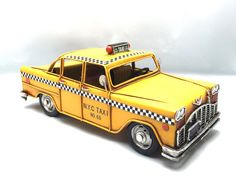 Vintage yellow NYC taxi miniature decorative by GiftlandDeco