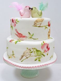The birds! Love this wedding cake | 10 Watercolour Wedding Cakes Almost Too Lovely To Eat via @weddingbellsmag