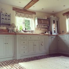 Like most country kitchen styles, the English country kitchen style can be traced back to rural cottages and farming communities over the last few hundred years. Huge importance is placed on creating Brick Floor Kitchen, Kitchen Flooring, Kitchen Cabinets, White Cabinets, Grey Cupboards, Cottage Kitchens, Grey Kitchens, Home Kitchens, Rustic Kitchens