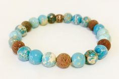 A personal favorite from my Etsy shop https://www.etsy.com/ca/listing/519844516/jasper-gemstone-bracelet-lava-stone