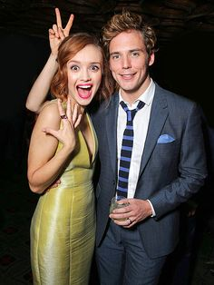 PEACE BE WITH YOU | Whose hand is that? Olivia Cooke and Sam Claflin get photobombed by a sneaky bystander while premiering their new film, The Quiet Ones, in L.A. on Tuesday.