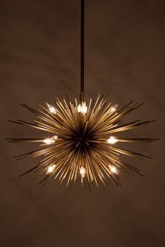 Astra Chandelier - Anthropologie.com I'm a little surprised Anthro...this is a little Jonathan Adler for you guys.  But I love it.   #anthrofave #juvenilehalldesign