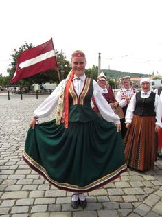 This costume is from Rucava, a Curonian town relatively near the border with Lithuania - seems to show influence of Lithuanian folk costumes. (Folk dance ensemble Katlakalns.) - Marmota's Dress Diaries: Latvian folk costumes in Prague