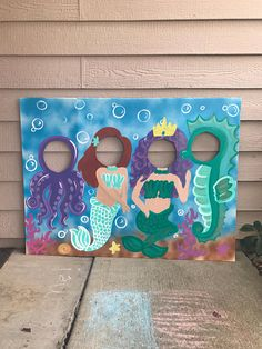 This will add the perfect touch to your Mermaid party! Kids love posing in these, and the pictures could be sent to party guests in their thank you card. This has been painted by hand onto a sturdy 3 foot tall, 4 foot wide trifold display board. There is lots of shiny glitter on these