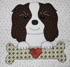 Spaniel applique wall hanging.  Dog quilt.