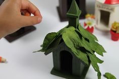 turning a miniature birdhouse into a fairy house for a garden at the blue boo