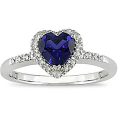 Heart of the Ocean ring style.. I like it! :) I want this for my engagement ring