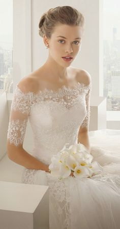 Romantic off the shoulder wedding dress.