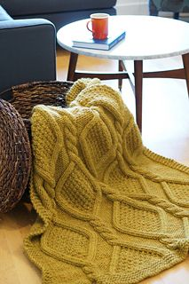 Kate Bostwick knitting pattern. Ribbon Weed. Thick cabled blanket with seed stitch and reverse stockinette stitch. Garter stitch border.  $5 for pattern.