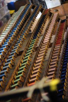 Bobbins on the creel #whitchurchsilkmill #weaving #warping