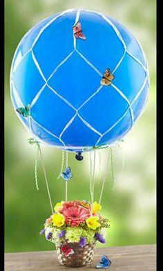 Arreglo floral globo de aire caliente