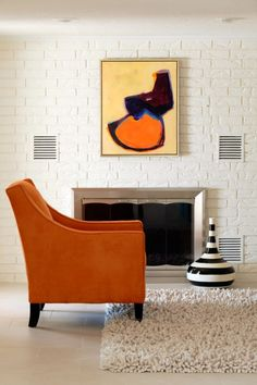 Orange gives this tailored arm chair a less traditional, more contemporary look.  Pop!