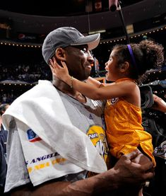 June 2009 — Kobe Bryant celebrates w/ daughter Gianna after the Lakers won to win the NBA Championship against the Orlando Magic in Game Five of the 2009 NBA Finals at Amway Arena in Orlando, Florida Kobe Bryant Family, Kobe Bryant 24, Basketball Kobe, Kobe Bryant Tattoos, Cherokee, Kobe Bryant Daughters, Justin Bieber, Maori, Tatoo