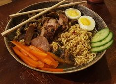 A little Monday evening Ramen to spice up this week.  Everyday I look on Instagram and see a the beautiful things I want to eat at beautiful restaurants I may never go to.... and then I just make it myself.   And can sit on my couch after  #ramen #eggs #pork #cheflife #homemade #makeitathome #wenevergoout #parentlife #ramenbowl #yum #foodporn #instagood #cucumber #yellowpeppers #mushrooms #chopsticks #ramennoodles #fromscratch #7minuteegg Ramen Bowl, Stuffed Mushrooms, Stuffed Peppers, Ramen Noodles, I Want To Eat, Chopsticks, Pot Roast, Spice Things Up, Cucumber