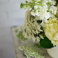 A closer look at the arrangement named for the way it makes us feel: Cloud Nine. 👀☁ We loooove the incredible texture added by  Queen Anne's Lace. | Follow us on Instagram- @mccarthyflorists for more! | Pictured is Queen Anne's lace, white hydrangea, and white stock in a lovely Accent Decor container | Photo belongs to McCarthy Group Florists.