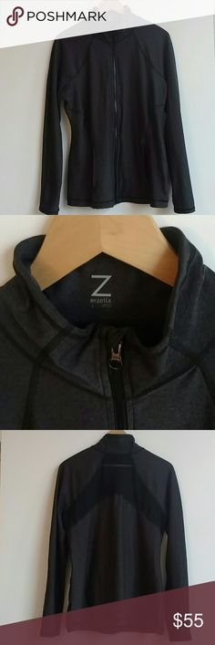 Z by Zella Activewear Polyester Gray Zip jacket L Z by Zella charcoal gray active-wear jacket. Size Large. Zip front with a flap detail at the top of zipper that hides top of zipper. 2 pockets in front and a thumb-hole on each sleeve (see photo.) Body: 88% polyester, 12% spandex. Mesh detail on back is 80% polyester, 20% spandex. Upper back of jacket is a sheer mesh....this workout jacket screams sexy and sophisticated! Gently used but is is super condition with no signs of wear…
