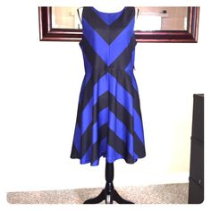 Never worn!!! New York and Company A-line dress Stretch black and blue dress with a zipper back New York & Company Dresses Midi