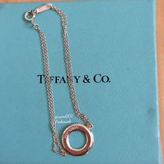 """Tiffany & Co. Circle Bracelet I received this as a gift but it's to dainty for me. Wore one time just to try it on so it's in excellent condition with no scratches. Has been stored in it's pouch and box. Comes with original box, pouch and care card. Measures approximately 6.5"""" from clasp to clasp. Perfect fashion statement for the working girl or for a romantic dress up date. Timeless and classy piece. Sold out and no longer being produced. TRADES Tiffany & Co. Jewelry Bracelets"""