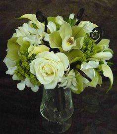 White and green bridal bouquet.  Flowers of Charlotte loves this!