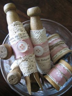 DIY~ Shabby Clothespins  :: Wrapped in lace, old book paper, jute, vintage fabric and topped with a button. Use as décor.
