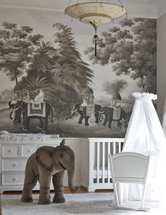 You might also consider thinking outside the box with a traditional print in black and white. This colonial mural creates a whimsical focal point that won't seem too babyish once Junior reaches grade school.