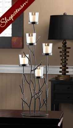 This fantastic candleholder is the perfect blend of contemporary design, natural inspiration, and shimmering candlelight. Five clear glass candlecups sit perched upon iron branches for a dramatic disp Candle Stand, Candle Holders, Candle Cups, Glass Candle, Iron Springs, Sculpture Metal, Diy Home Decor, Room Decor, Candle Lanterns