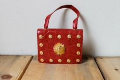 Vintage 1980's Red And Gold Handbag. $69.00, via Etsy.
