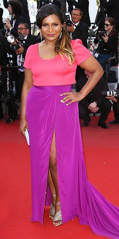MINDY KALING | in a pink and purple colorblock gown featuring a thigh-high slit, paired with shiny silver accessories at the Inside Out premiere.