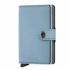 Secrid Blue Matte Leather Mini Wallet : Based on the Secrid Cardprotector, the Miniwallet is both a compact and secure wallet. In addition to the cards in the Cardprotector, the interior offers space for a few cards, paper money, receipts, business cards and some coins.  The Miniwallet is compact and, because of the press stud closure, easy to carry. This corrected grain leather is made from European cowhides. It has a matte finish which makes the leather stain- and scratchproof.