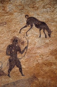 Rock art showing a man with bow and a dog, from the pastoral period of Saharan art. Ancient History, Art History, Paleolithic Art, Art Rupestre, Cave Drawings, Art Antique, Ancient Artifacts, African Art, Rock Art