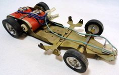 Buzco X Series slot car chassis with can motor.