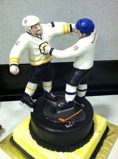Hockey Fight Cake  done by: Michelle's Cake Designs for a Bruins Alumni Charity Event  Very cool cake!!!!