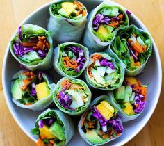 Thai Basil Summer Rolls: 8 rice paper wrappers, a few leafy greens (butter lettuce, soft lettuce), 1 medium cucumber, 2 medium carrots, 1/4 of small red cabbage, a handful of fresh mint or thai basil, 1 avocado, a couple green onions, 1 mango, crushed peanuts for topping. Slice ingredients into 3-inch strips and roll.