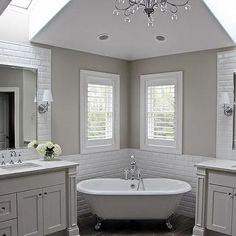 Corner Claw Foot Tub with White Beveled Subway Tiles