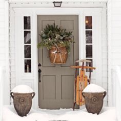 love the color of the door as an exterior accent color on a white house