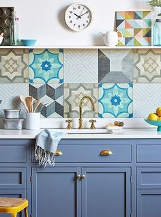 Kitchen with blue cabinets, white countertop ; bohemian style tiles as backsplash